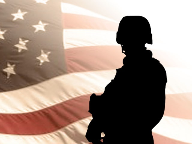 soldier with flag_1459827794482.jpg