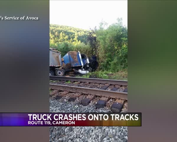 Truck Crashes Down Hill Onto Railroad Tracks_20160720035603