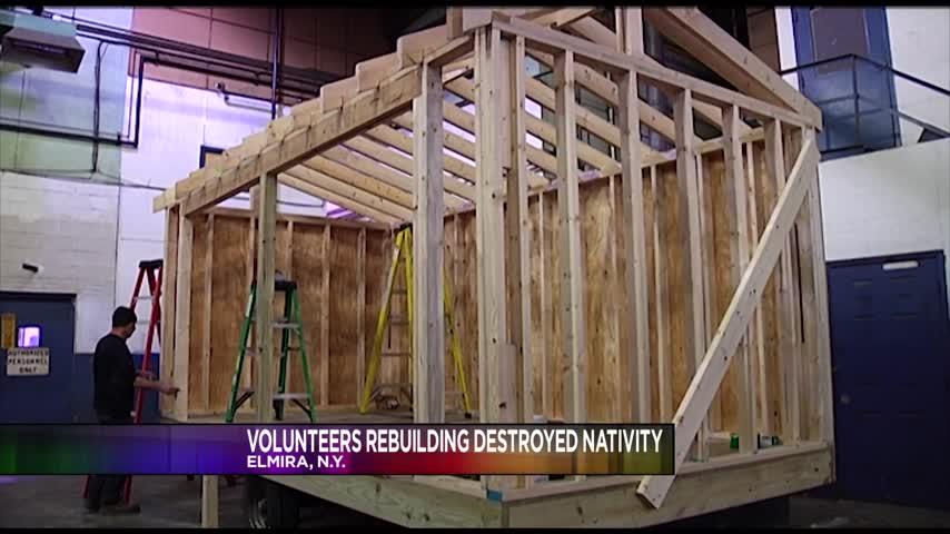 Volunteers Rebuilding Destroyed Nativity_54779262