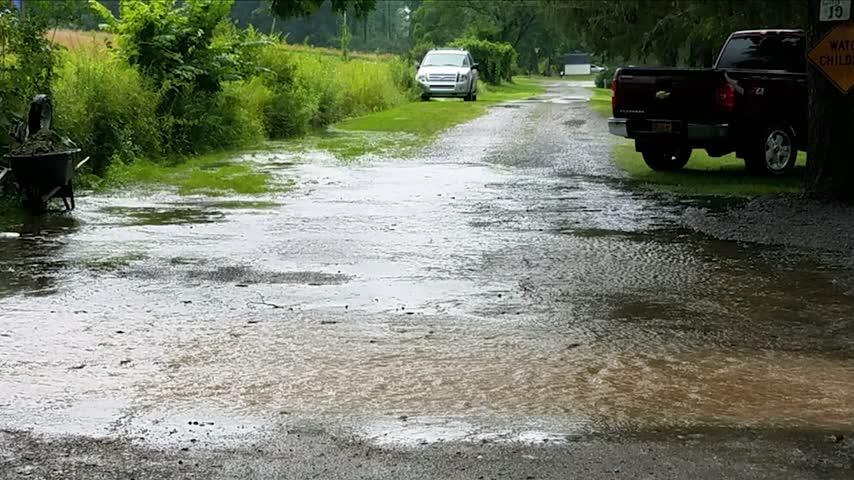 DPW improving roads- one street still under water_25408771