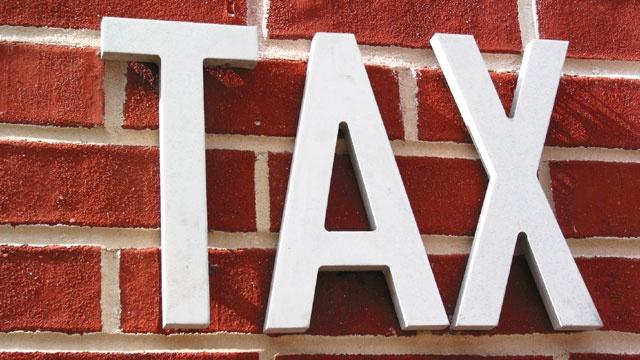 tax sign on wall, taxes_3751791819650970-159532