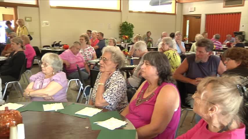 Senior citizens leaning on Corning Senior Center for support_63027595