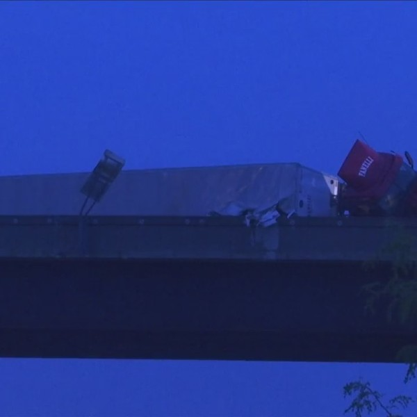 Tractor trailer flipped on its side on I-86