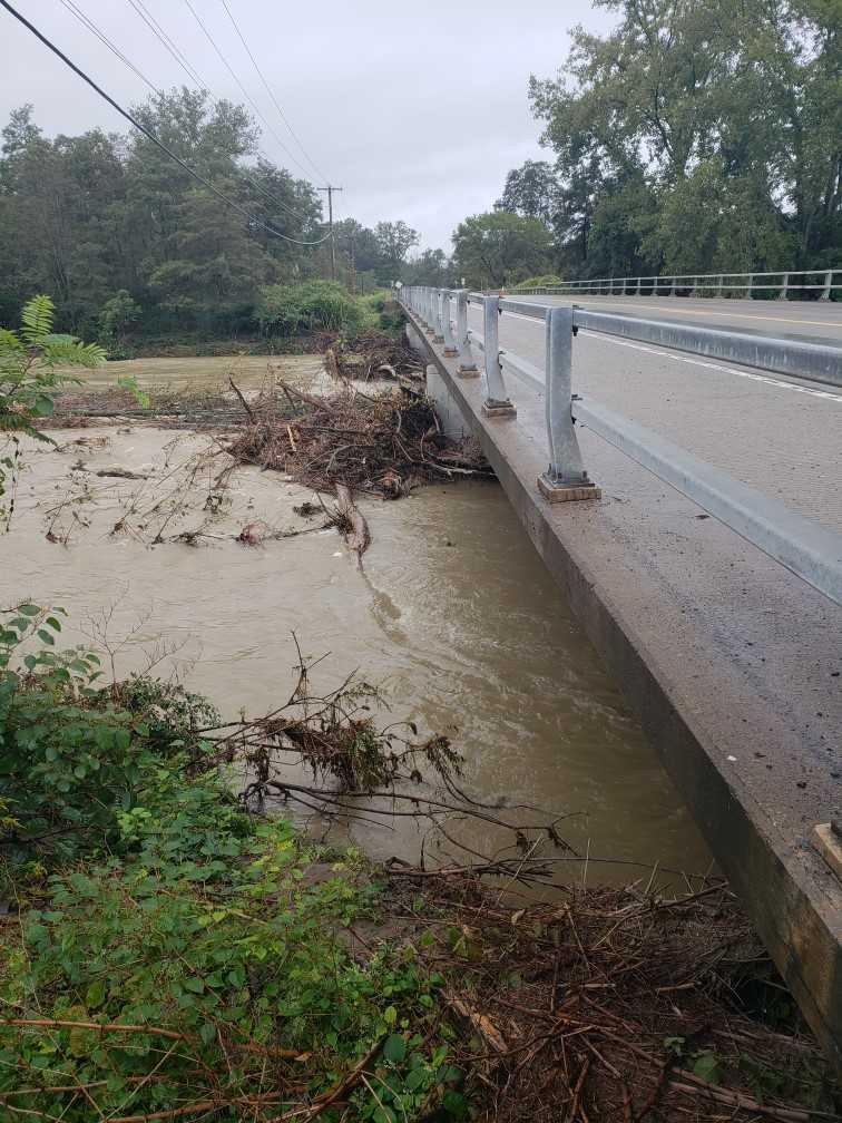flood debris under bridge_1537897656723.jpg.jpg