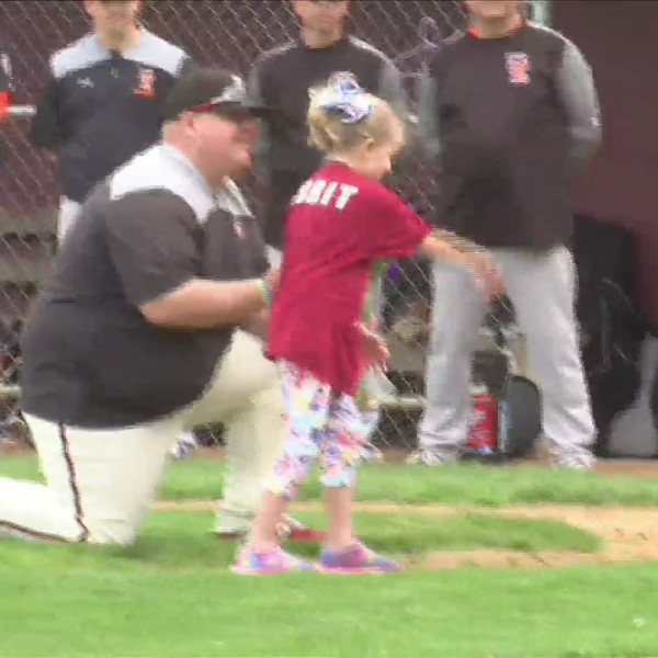 1st grader throws pitch