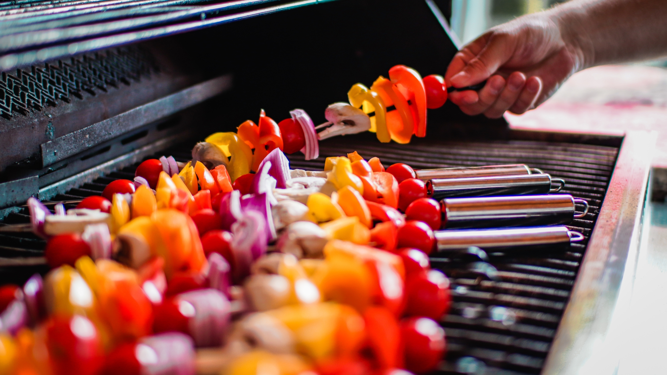 Grilling kabobs on grill
