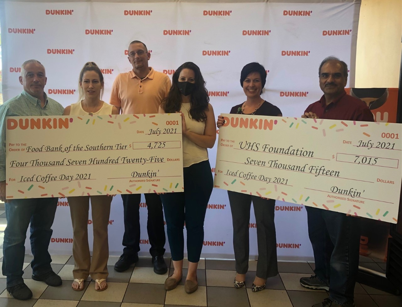 Dunkin presents donations to the UHS Foundation for $7,015 and the Food Bank of the Southern Tier for $4,725 at the Dunkin' located at 3000 Vestal Parkway in Vestal, NY. The donations are the result of Dunkin's annual Iced Coffee Day fundraising campaign, held on May 26 at participating Dunkin' restaurants throughout the Southern Tier.